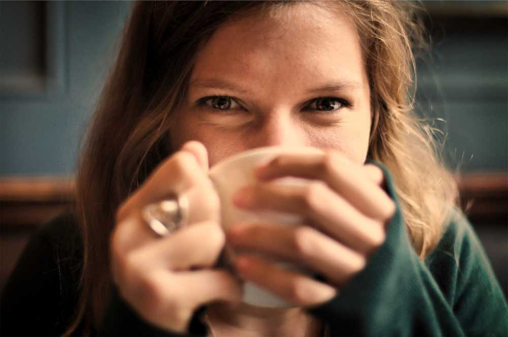 Happy girl drinking weed tea